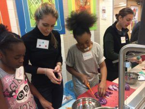 JL Boston volunteers and program participants at Kids in the Kitchen