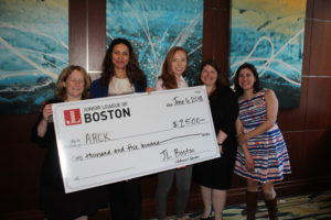 JL Boston members and grant recipients from ARCK holding a giant check