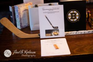 Photo of auction items at an event that are part of a Boston Bruins package