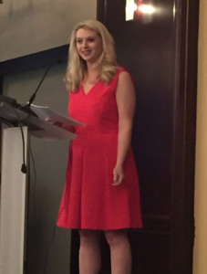 Michelle Lentz giving her remarks as incoming JL Boston President at the June 2018 GMM.